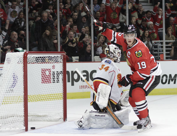 ... his teammate Brent Seabrook's (not pictures) goal Calgary Flames' Miikka ...