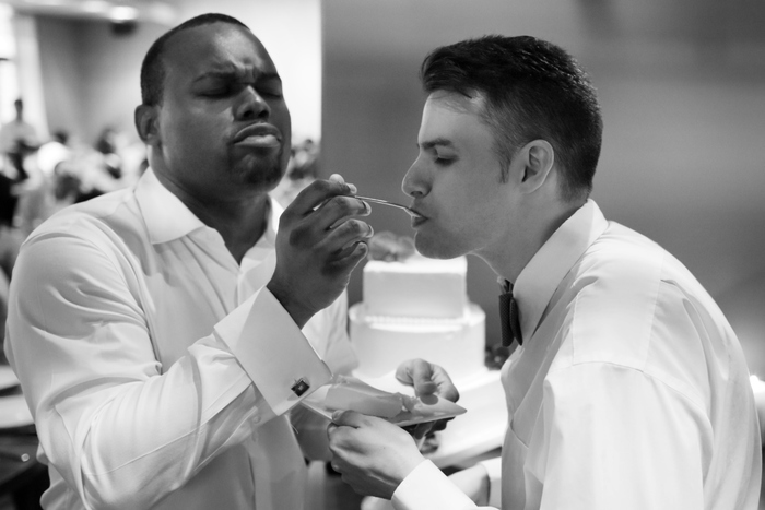 Chicago Black & White Gay Wedding Photographer captures cake cutting
