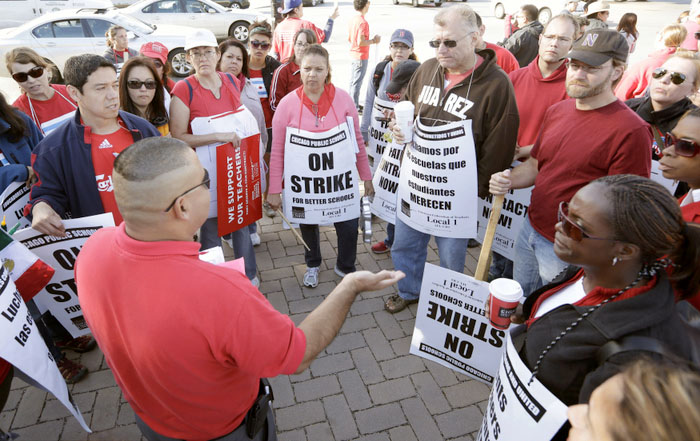 Members of the Chicago Teachers Union plan their day outside the Benito Juarez High School on the fifth day of their strike in Chicago, September 14, 2012.