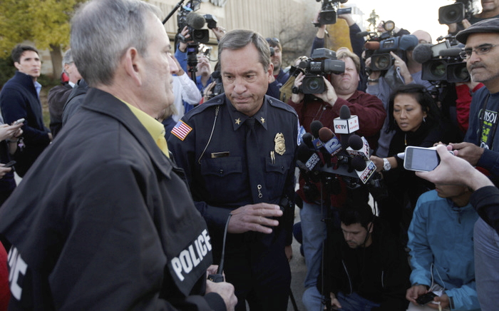 Brookfield Police Chief Dan Tushaus leaves a press conference outside the Brookfield Square mall in Brookfield, Wisconsin, October 21, 2012. Three people were killed and at least four injured in a shooting on Sunday in a Wisconsin spa. REUTERS/John Gress