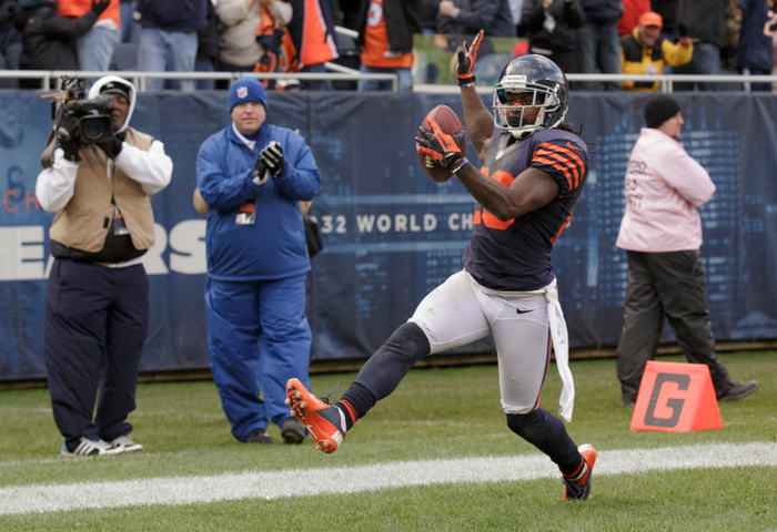 CHICAGO, IL - OCTOBER 28:  Tim Jennings #26 of the Chicago Bears celebrates scoring a touchdown on an interception against the Carolina Panthers on October 28, 2012 at Soldier Field in Chicago, Illinois.  The Bears defeated the Panther 23-22. (Photo by John Gress/Getty Images)