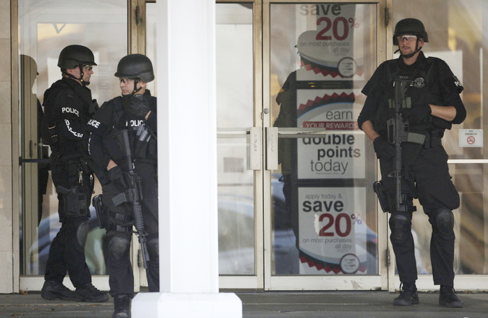 Police stand guard outside the Boston Store, part of the Brookfield Square mall in Brookfield, Wisconsin, October 21, 2012. Three people were killed and at least four injured in a shooting on Sunday in a Wisconsin spa, Brookfield Police Chief Daniel Tushaus said at a news conference. REUTERS/John Gress