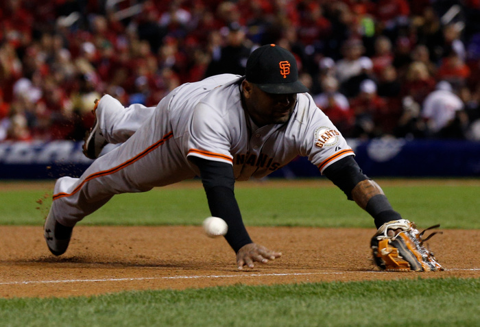 San Francisco Giants third baseman Pablo Sandoval (48) is unable to reach a double by St. Louis Cardinals' Allen Craig in the fourth inning during Game 5 in their MLB NLCS playoff baseball series in St. Louis, Missouri, October 19, 2012. REUTERS/John Gress