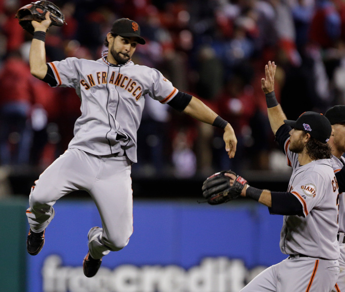 San Francisco Giants center fielder Angel Pagan celebrates with teammates Brandon Crawford and Hunter Pence (R) after their team defeated the St. Louis Cardinals in Game 5 in their MLB NLCS playoff baseball series in St. Louis, Missouri, October 19, 2012. REUTERS/John Gress