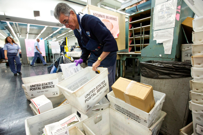 United States Postal Service mail Letter Carrier Rafael Matos sorts mail at the Lincoln Park Carriers Annex in Chicago, November 29, 2012. REUTERS/John Gress