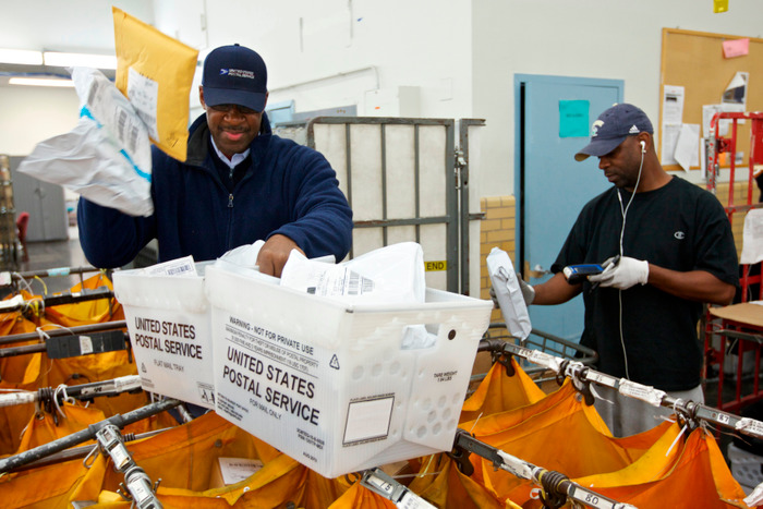 United States Postal Service clerks sort mail at the USPS Lincoln Park Carriers Annex in Chicago