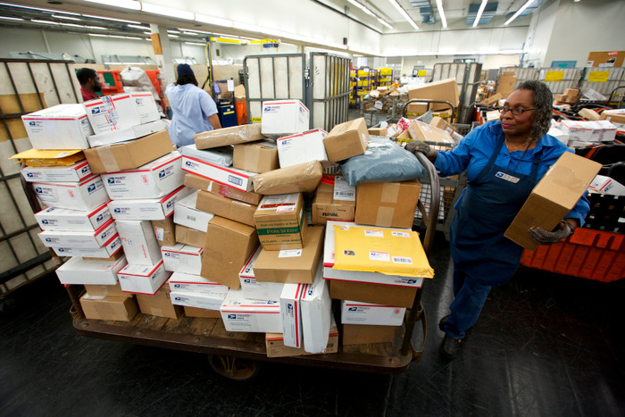 A United States Postal Service mail clerk Rosemary Spiewak sorts packages at the Lincoln Park Carriers Annex in Chicago, November 29, 2012. REUTERS/John Gress