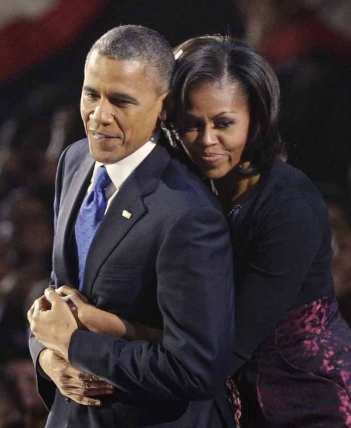 U.S. President Barack Obama is embraced by first lady Michelle Obama after his victory speech during his election night rally in Chicago, November 6, 2012. REUTERS/John Gress