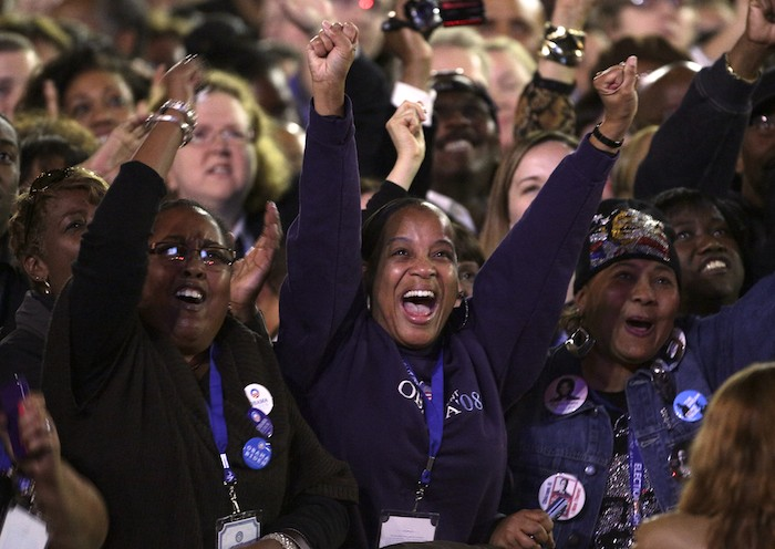 Supporters of U.S. President Barack Obama cheer during his election night rally in Chicago, November 6, 2012. REUTERS/John Gress