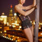 Female fashion model poses on a chicago watertower