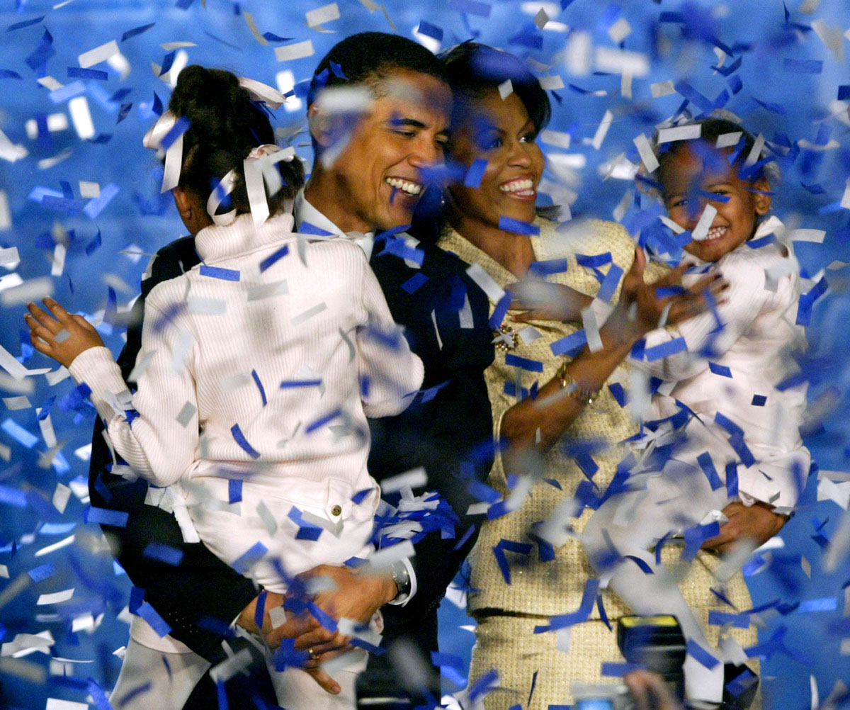 Illinois US Senate candidate Democrat Barack Obama celebrates with his family in Chicago