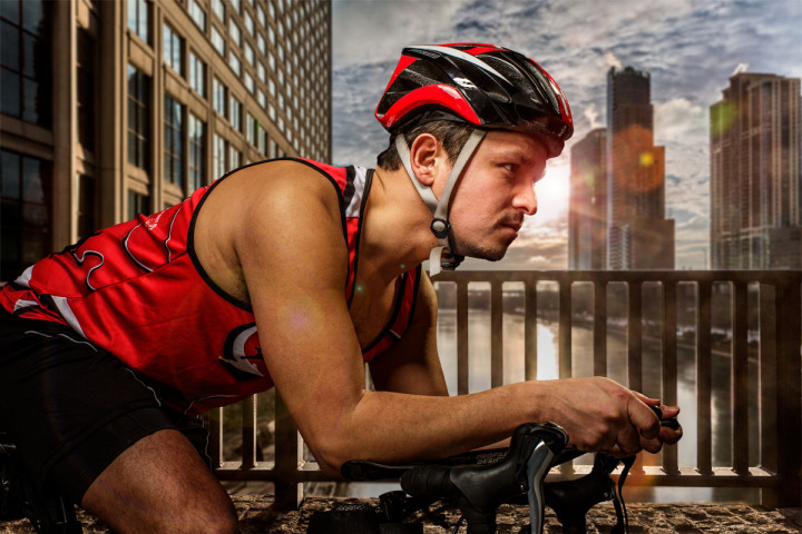 Model rides bicycle for charity ad campaign by Chicago sports photographer John Gress