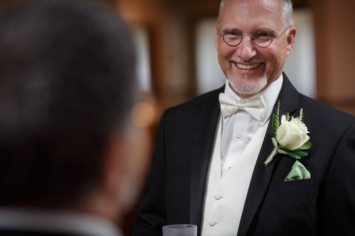 Gay grooms smile before their chicago wedding.