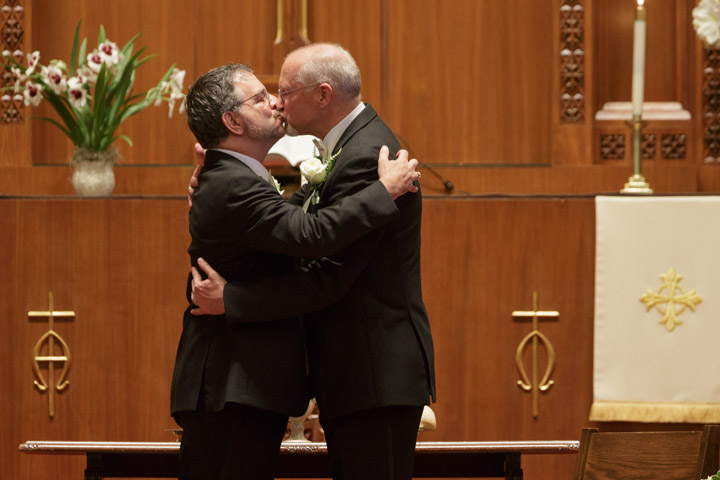 first kiss by Illinois LGBT Wedding Photographer