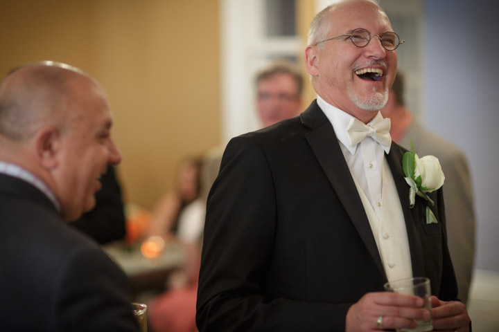 Gay groom laughs during gay wedding in Chicago