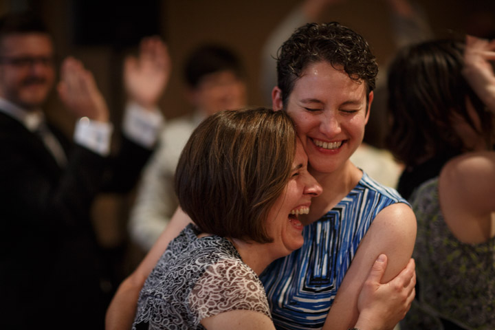 wedding guest laugh at Chicago Illinois LGBT wedding