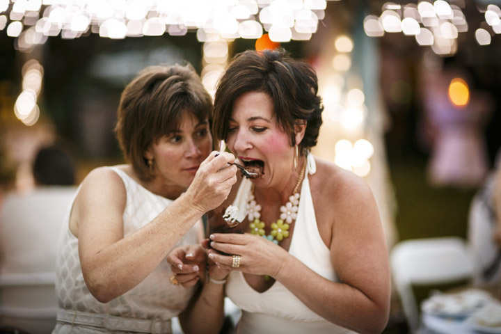 cutting the cake by Chicago Same-Sex Wedding Photographer lesbian