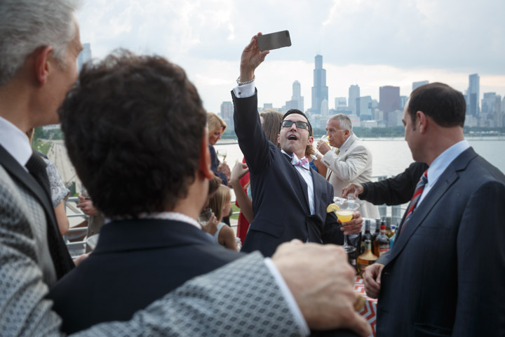A gay wedding guest takes a selfie in Chicago