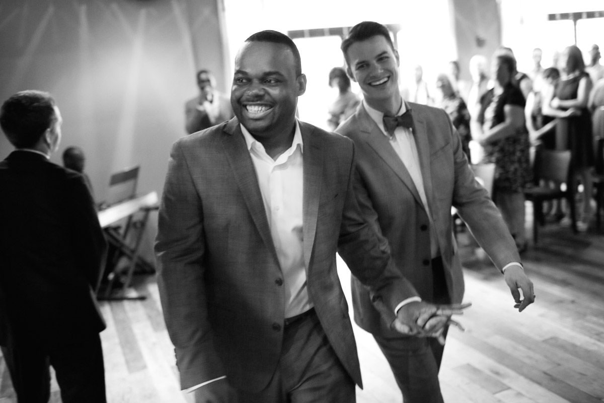 Chicago Wedding Photographer photography of smiling gay grooms after ceremony