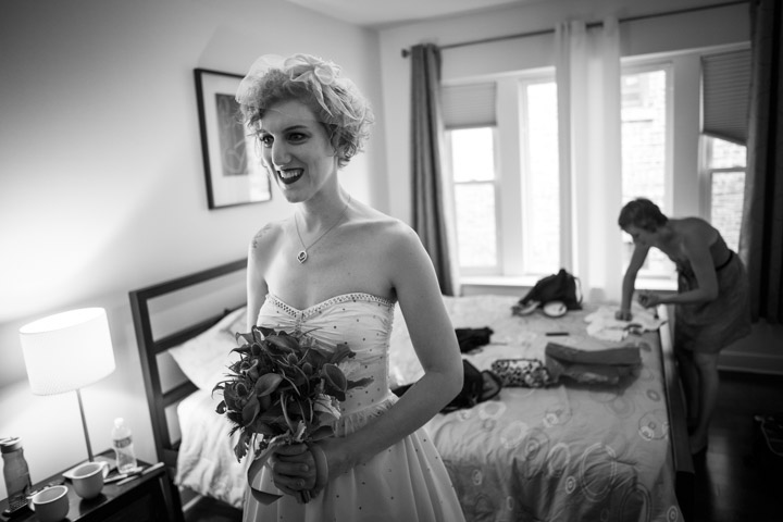 lesbian bride take last look in mirror before wedding