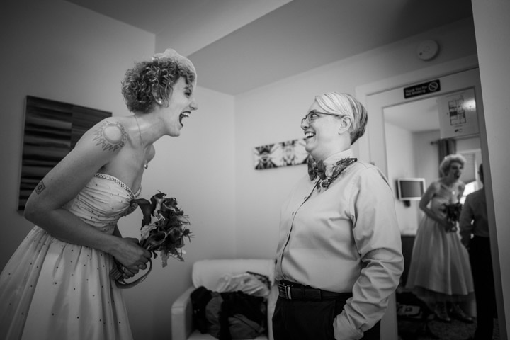 Lesbian bride laughs with matron of honor
