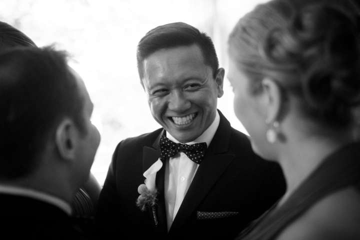 Illinois gay wedding photography of smiling groom in Chicago