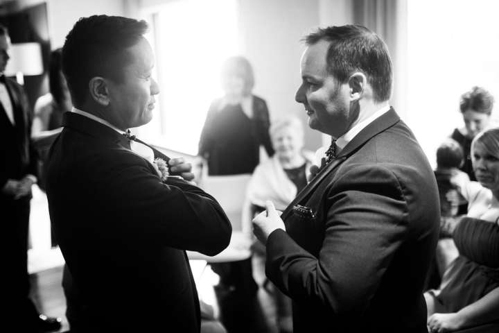 Illinois gay wedding photography of grooms making thier last minute preperations