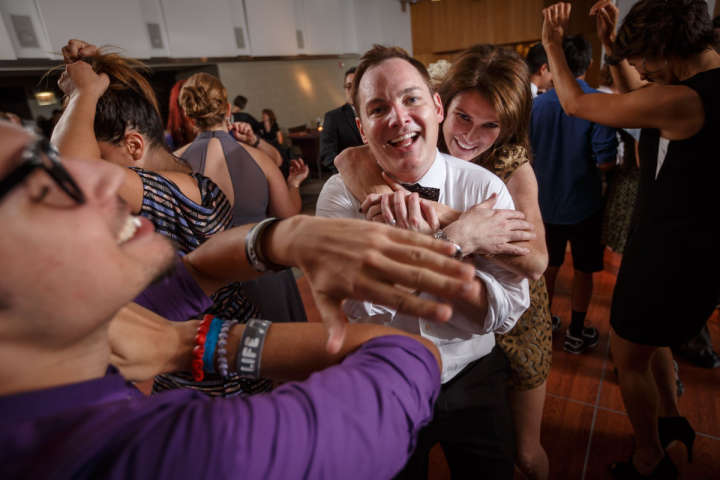 Illinois gay wedding photography of hug on the dance floor in Chicago