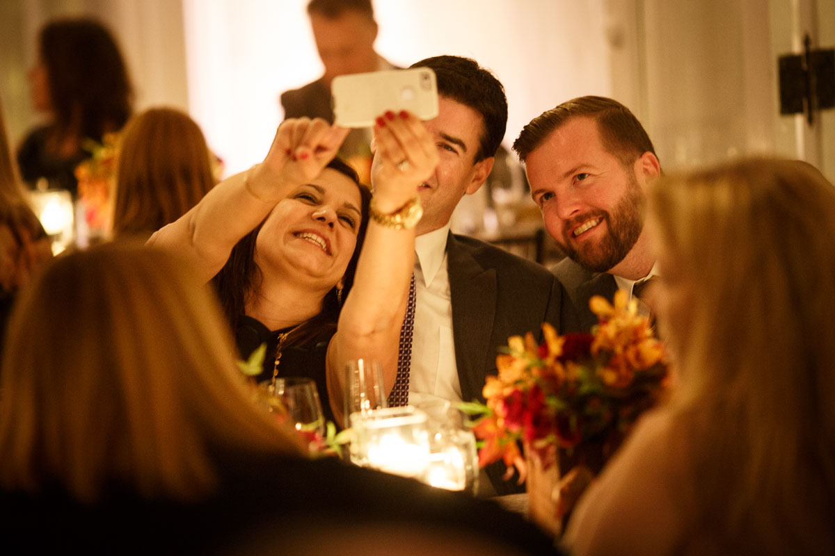 Chicago same-sex wedding photography of group selfie at a gay wedding