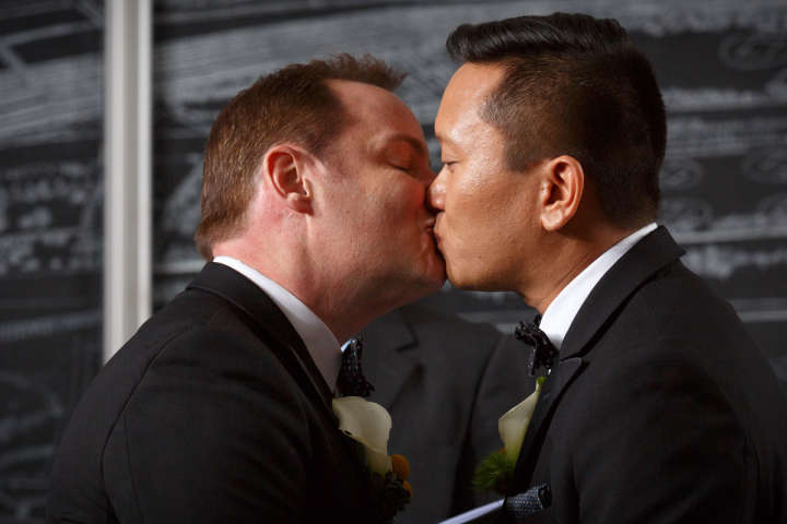 Illinois gay wedding photography of first kiss in Chicago