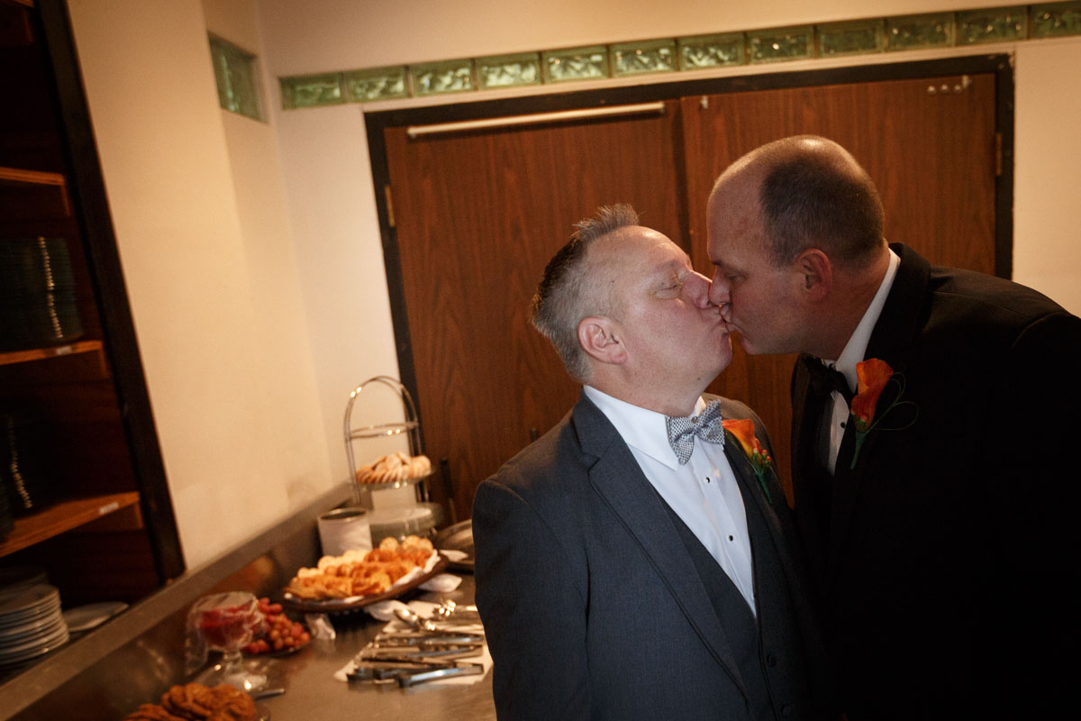 Chicago grooms kiss before their ceremony by Illinois Gay Wedding Photographer
