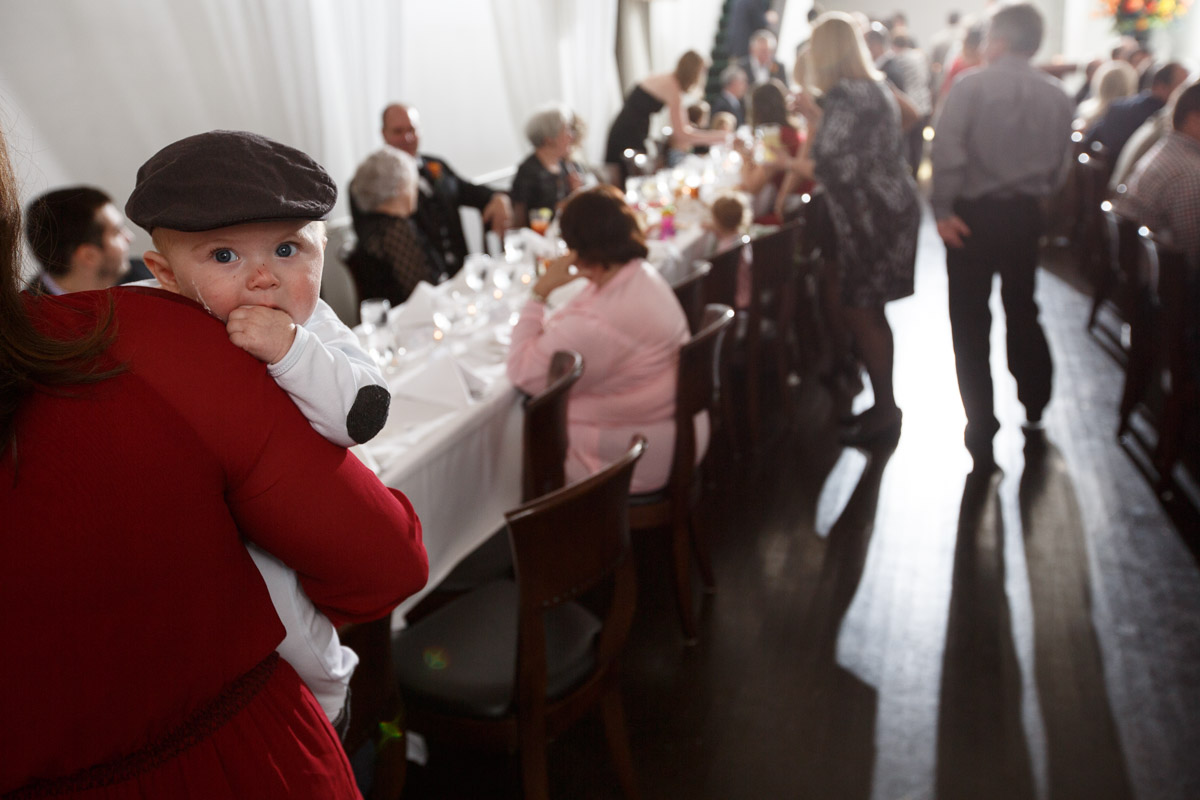 A baby attends a Chicago reception by Illinois Gay Wedding Photographer