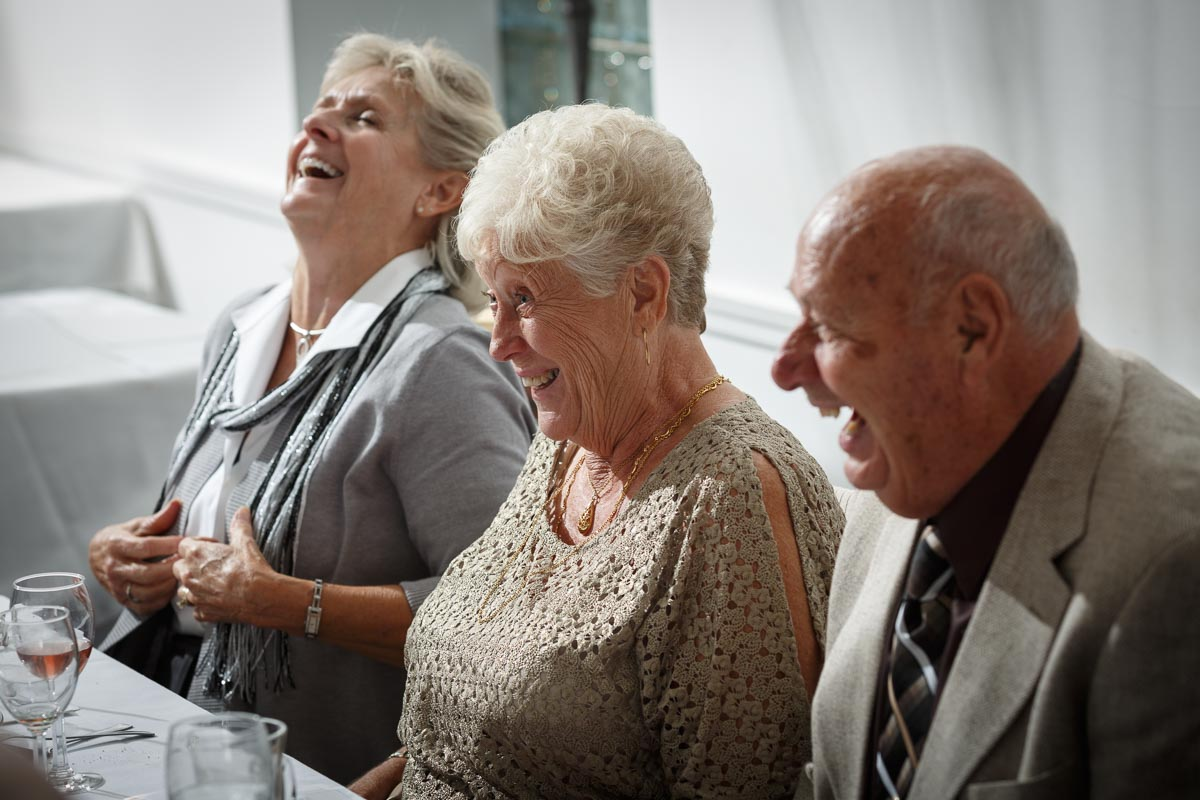 Laughing guests by Illinois Gay Wedding Photographer
