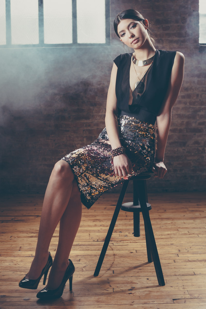 Chicago Fashion Photographer teen female model on stool in warehouse