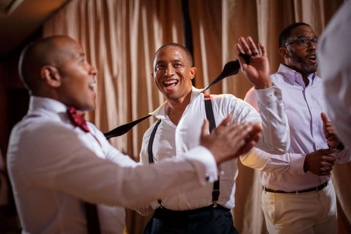 Evanston Gay Wedding photographer african american groom dances
