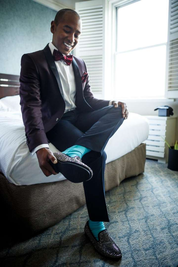 Black Gay Groom Gets readdy for wedding at Hilton Orrinton Hotel in Evanston Illinois