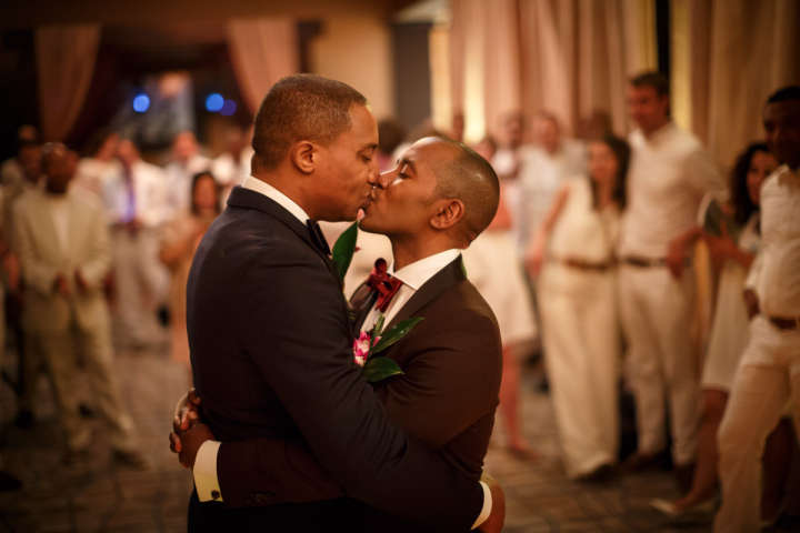 Evanston Gay Wedding photographer african american grooms have their first dance