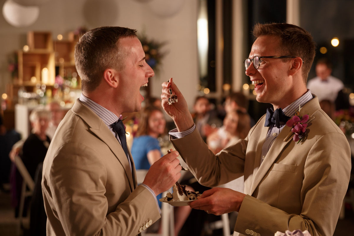 Gay couple curring the Cake during a wedding at the Peggy Notebaert Nature Museum in Chicago