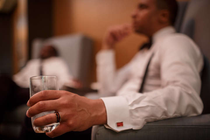 Evanston Gay Wedding photographer african american groom has drink with best man