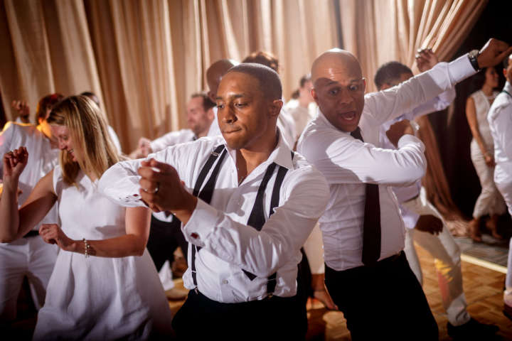 Evanston Gay Wedding photographer african american groom dances with guests