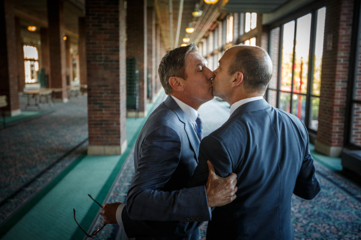Once last kiss before their gay wedding at Navy Pier in Chicago