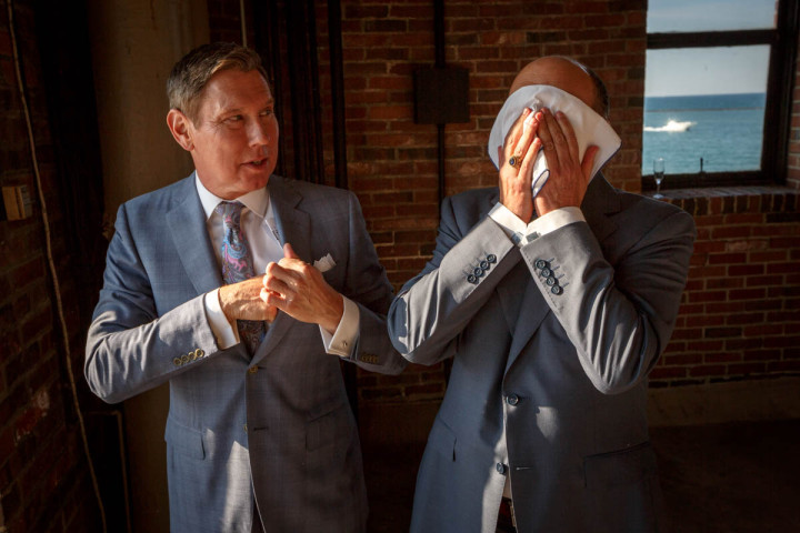 Gay grooms are overwhelmed with emotion before their wedding at Navy Pier in Chicago