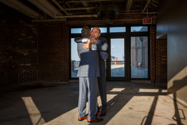 Gay grooms hug before thier wedding at Navy Pier in Chicago