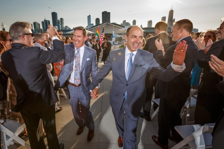 Illinois same-sex wedding photographer grooms leave wedding ceremony at Navy Pier