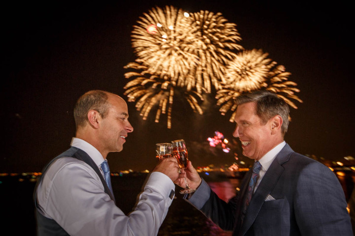 Illinois same-sex wedding photographer captures toast