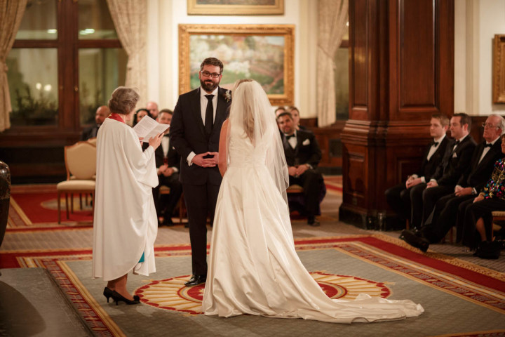 Chicago wedding photographer at union league club groom during ceremony