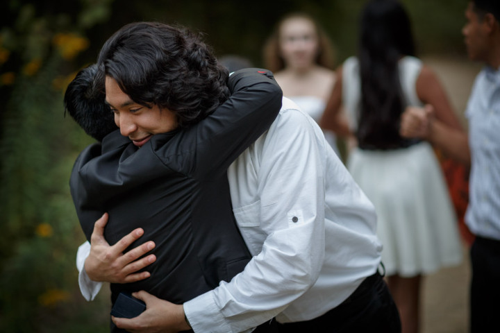 Bride hugs son by Chicago Suburbs Lesbian Wedding Photographer
