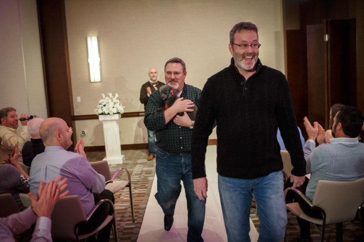 Gay wedding photography of a ceremony at The Park Hyatt by an amazing photographer dog