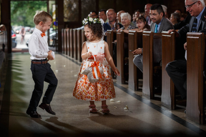 Chicago Gay Wedding Photographer captures grooms kissing before their wedding flower girl and ring bearer