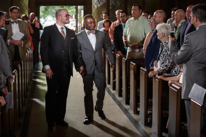 Chicago Gay Wedding Photographer captures grooms kissing before their wedding ceremony procession